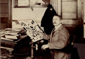 Photograph of political cartoonist Walt McDougal at work